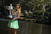 Виктория Азаренко, фото 205. Victoria Azarenka Posing with the Australian Open Trophy along the Yarra River in Melbourne - 29.01.2012, foto 205